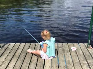 child fishing at Wilderness Escape Lodge